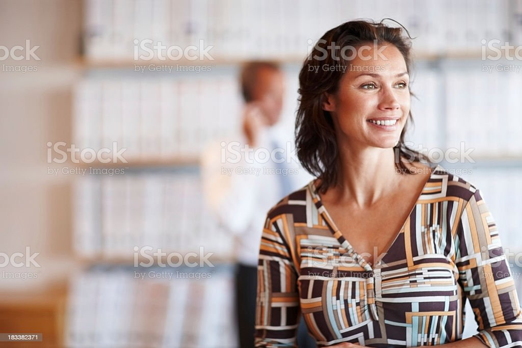 Businesswoman smiling and having creative thoughts royalty-free stock photo
