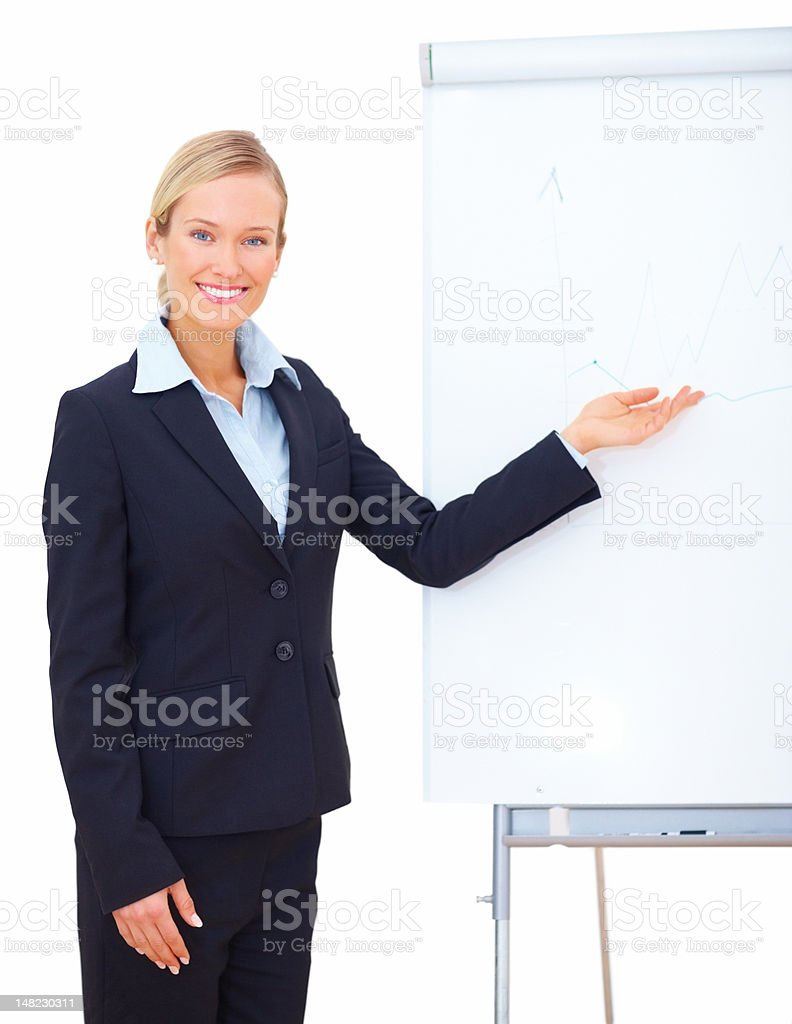 Businesswoman smiling and showing presentation in an office royalty-free stock photo