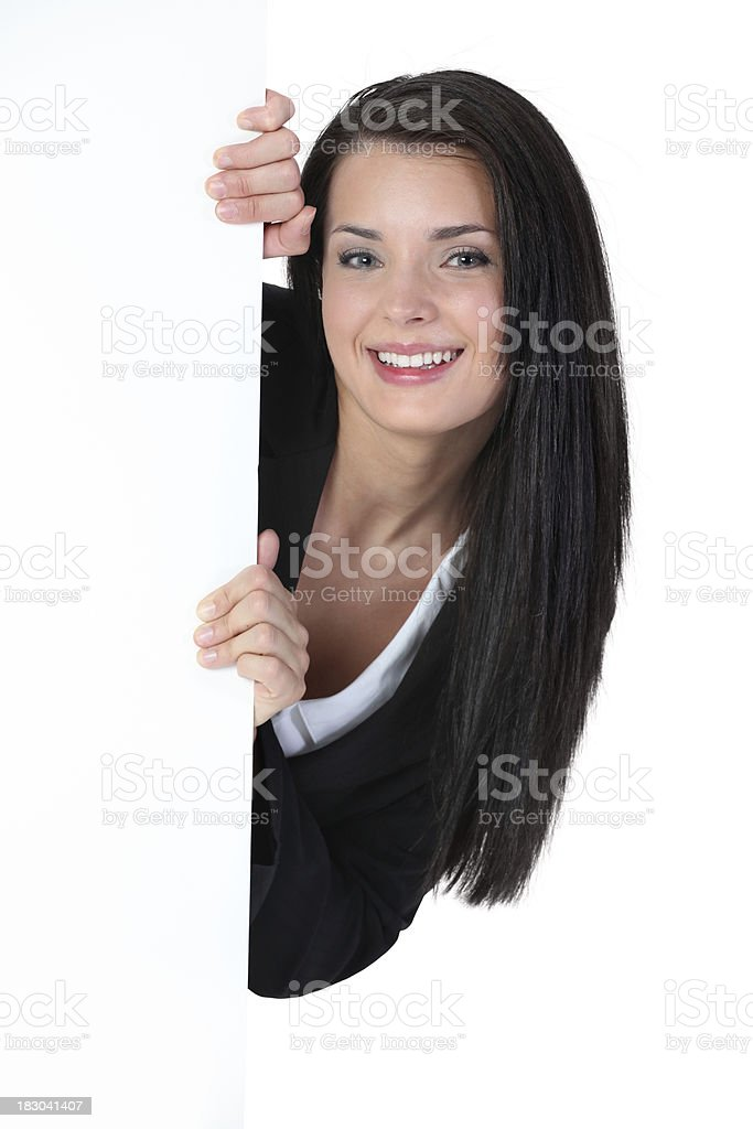 Businesswoman smiling from behind a placard royalty-free stock photo