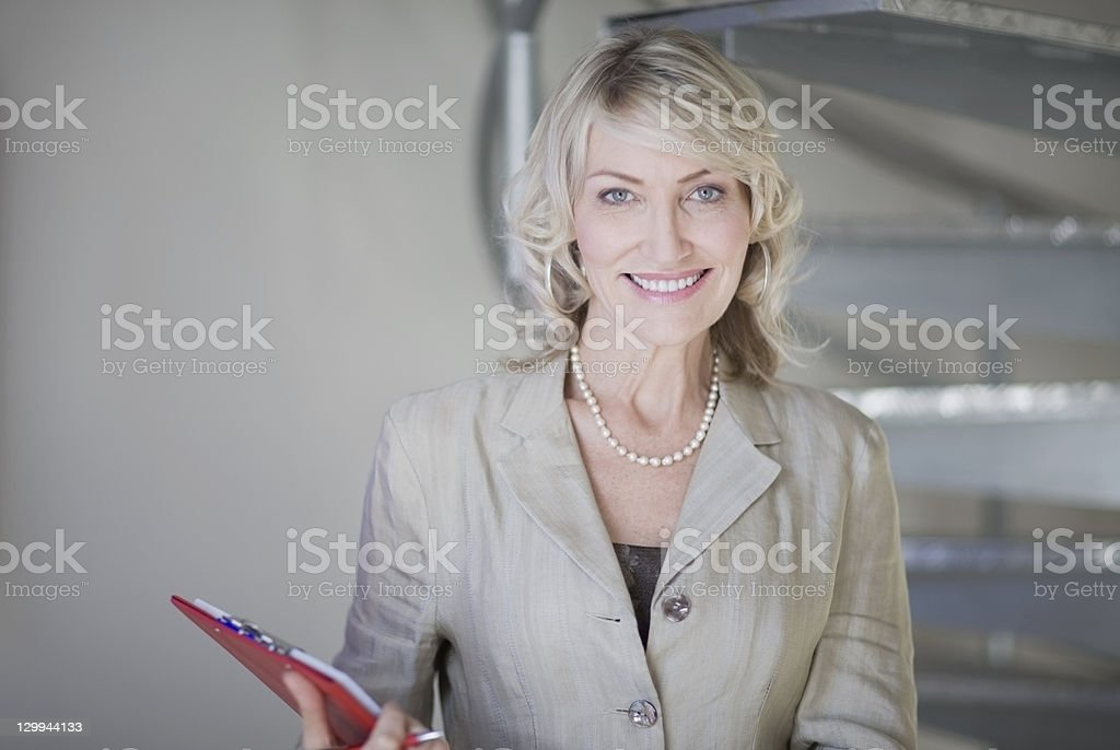 Businesswoman smiling in office royalty-free stock photo