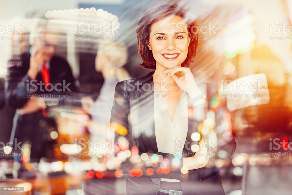 Businesswoman smiling to the camera stock photo