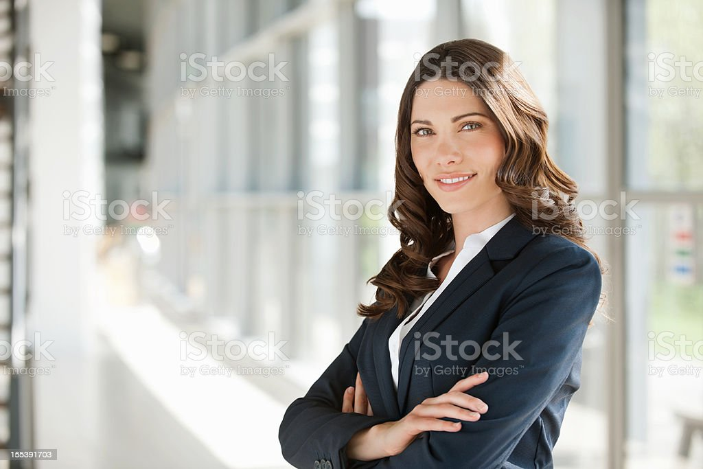 Businesswoman Smiling With Hands Folded stock photo