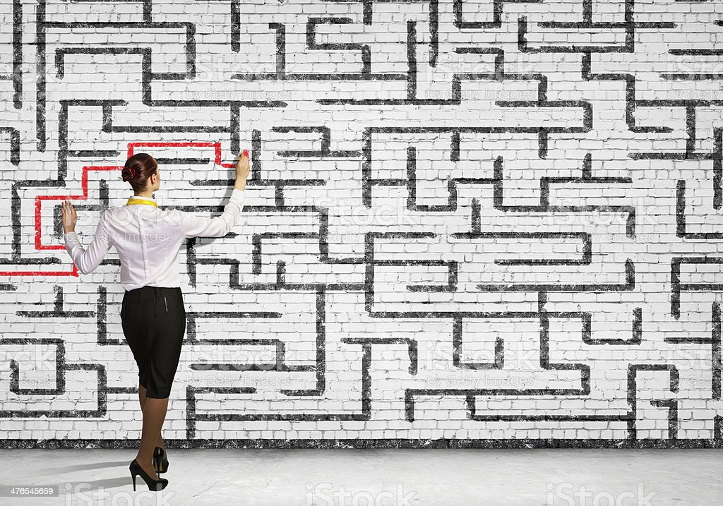 Businesswoman solving maze problem royalty-free stock photo