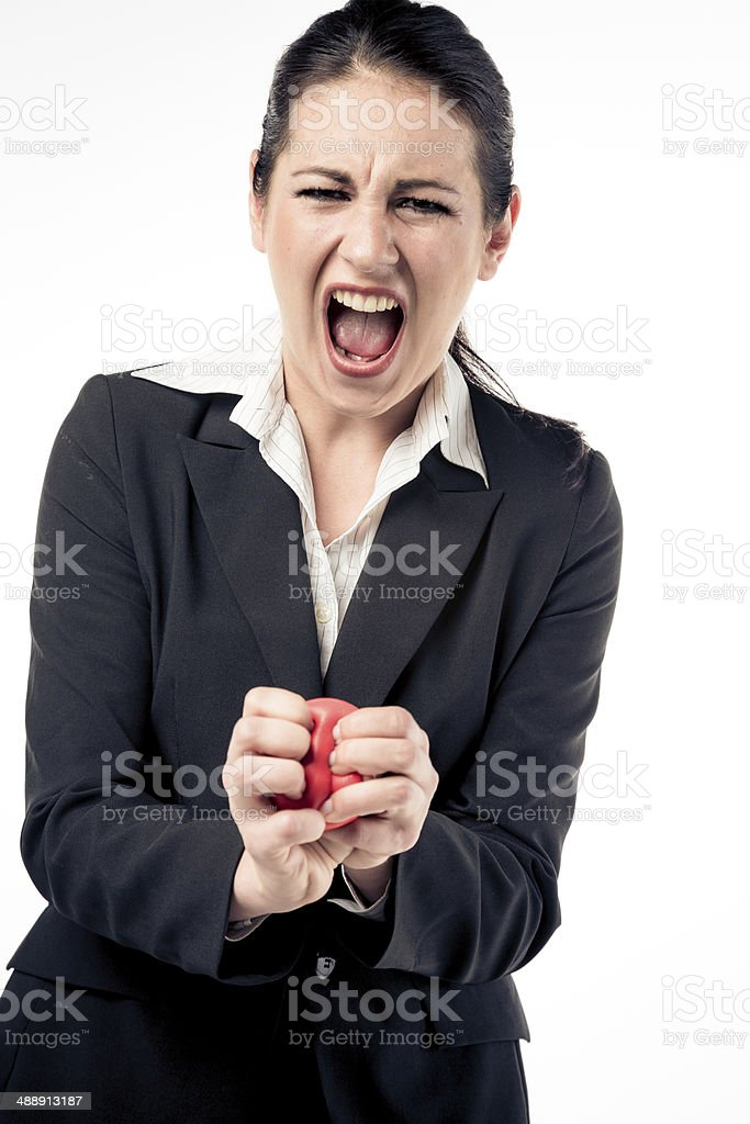 businesswoman squeezing stress ball stock photo