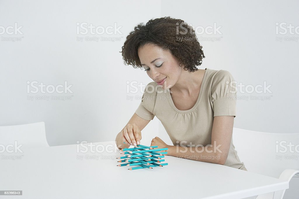 Businesswoman stacking pencils on desk royalty-free stock photo