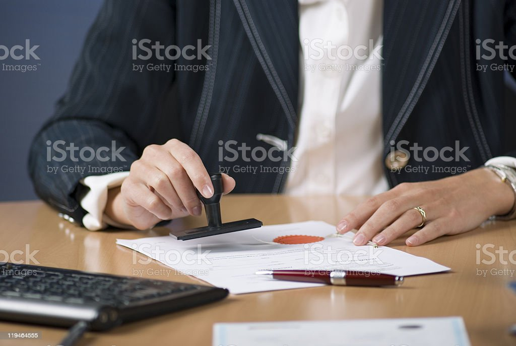 businesswoman stamping document stock photo