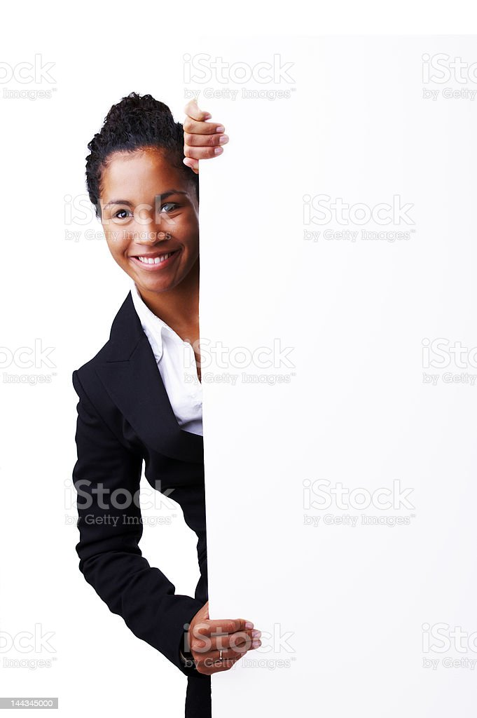 Businesswoman standing beside a billboard royalty-free stock photo