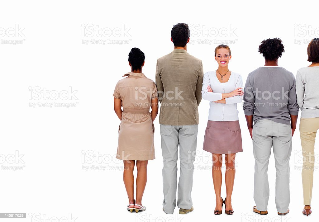Businesswoman standing between colleagues against white background royalty-free stock photo