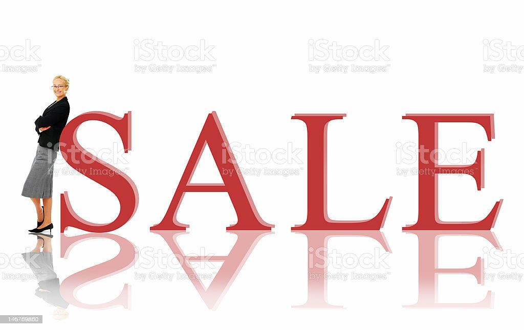 Businesswoman standing by sale sign royalty-free stock photo