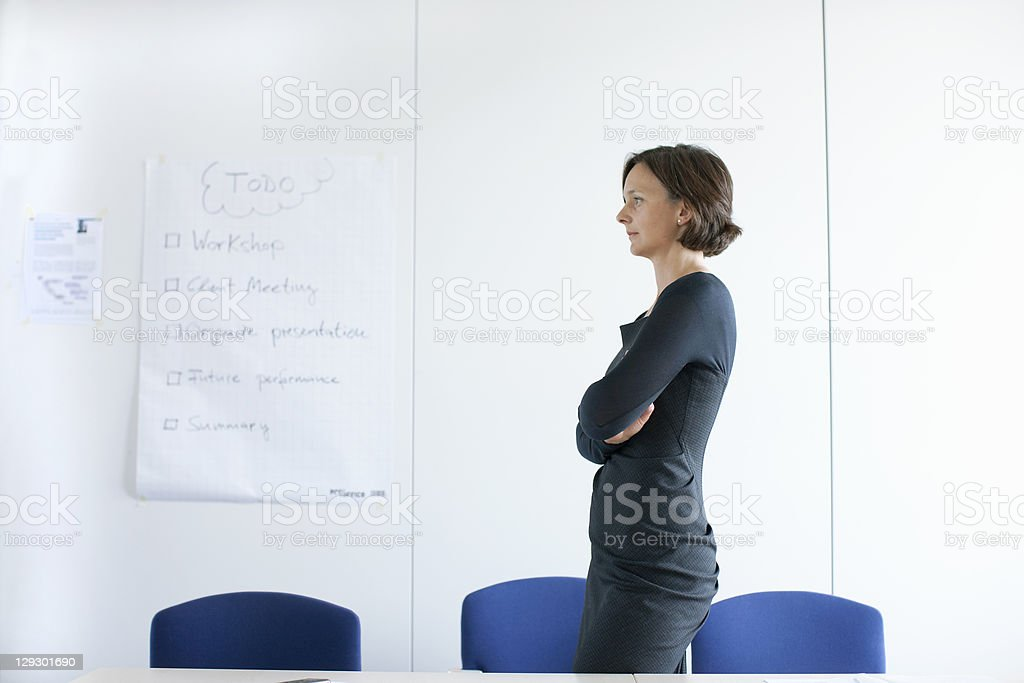 Businesswoman standing in empty office royalty-free stock photo