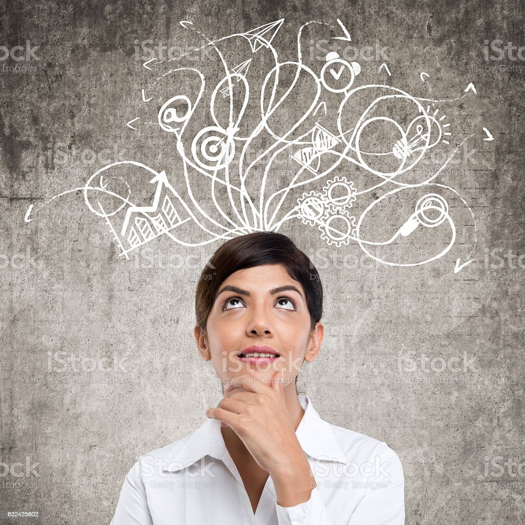 Businesswoman standing in front of wall stock photo