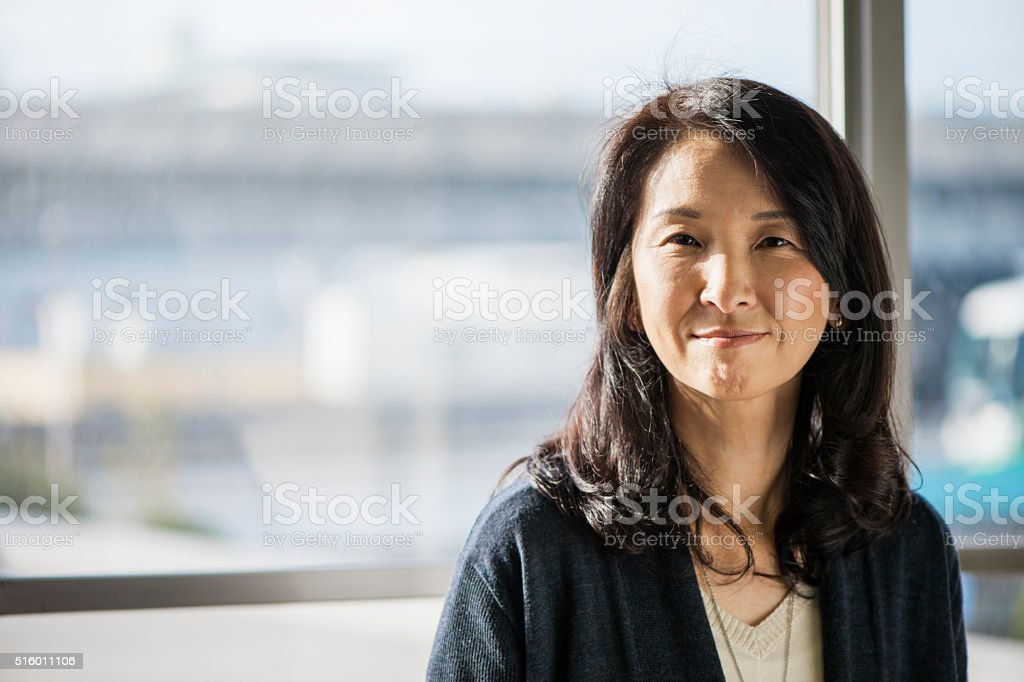 Businesswoman standing in the office of the window stock photo