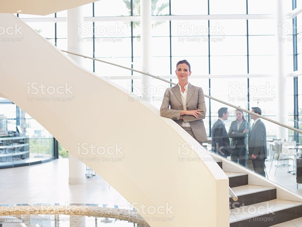 Businesswoman standing on staircase royalty-free stock photo