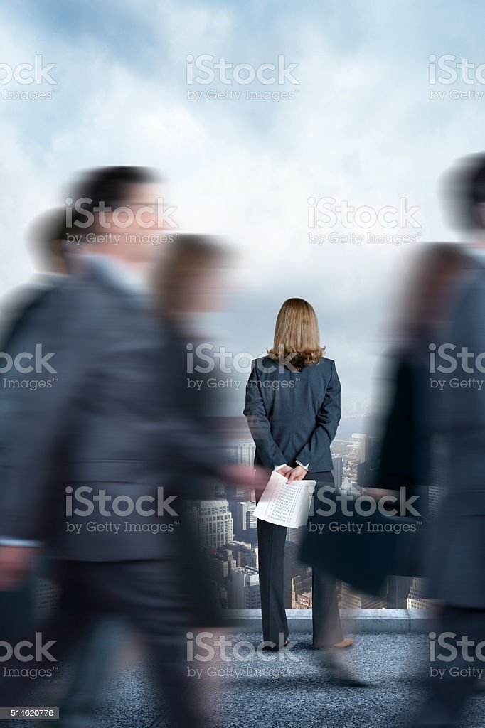 Businesswoman Standing On Top Of Building In The City stock photo