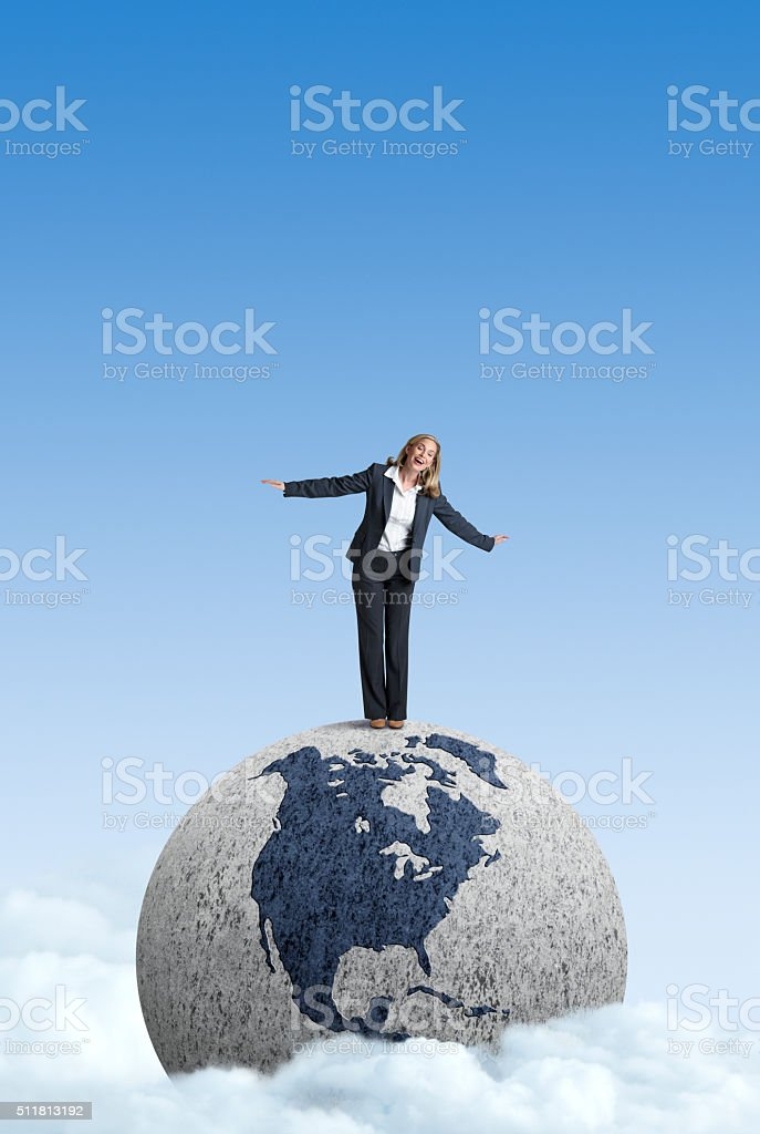 Businesswoman Standing On Top Of The World stock photo