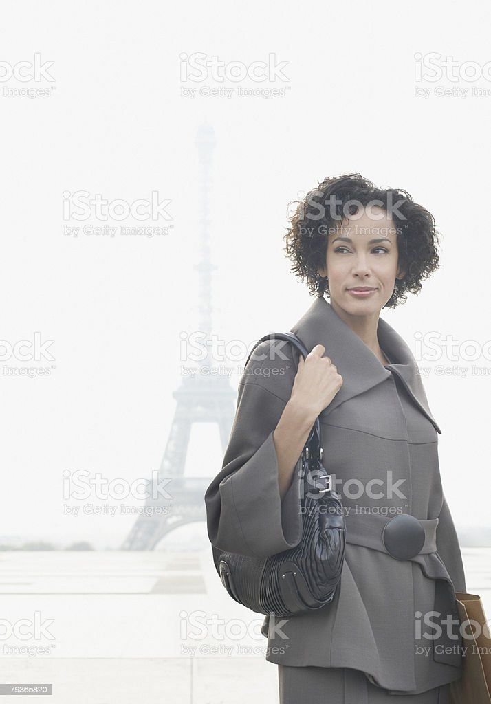 Businesswoman standing outdoors by the Eiffel Tower royalty-free stock photo