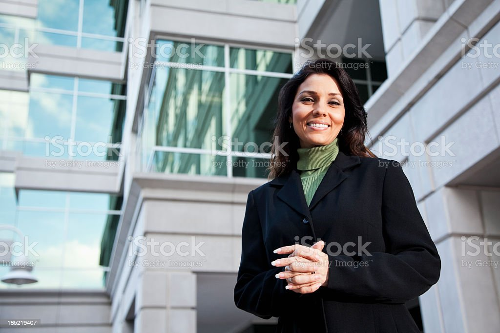 Businesswoman standing outside office building stock photo