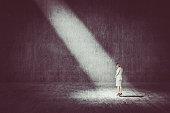 Businesswoman standing under the spotlight