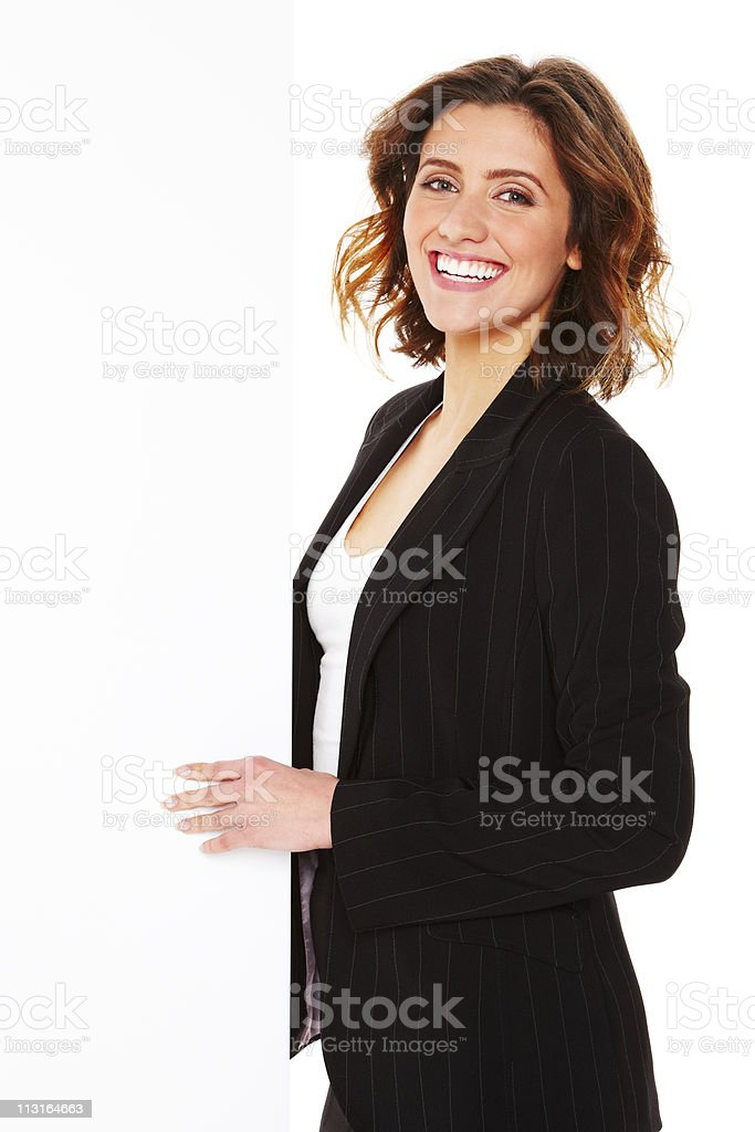 Businesswoman Standing with a Blank Placard - Isolated royalty-free stock photo