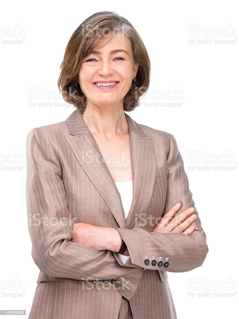 Businesswoman standing with arms crossed against white background royalty-free stock photo