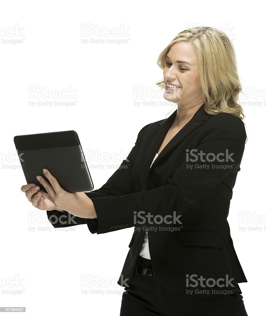 Businesswoman standing with digital tablet royalty-free stock photo
