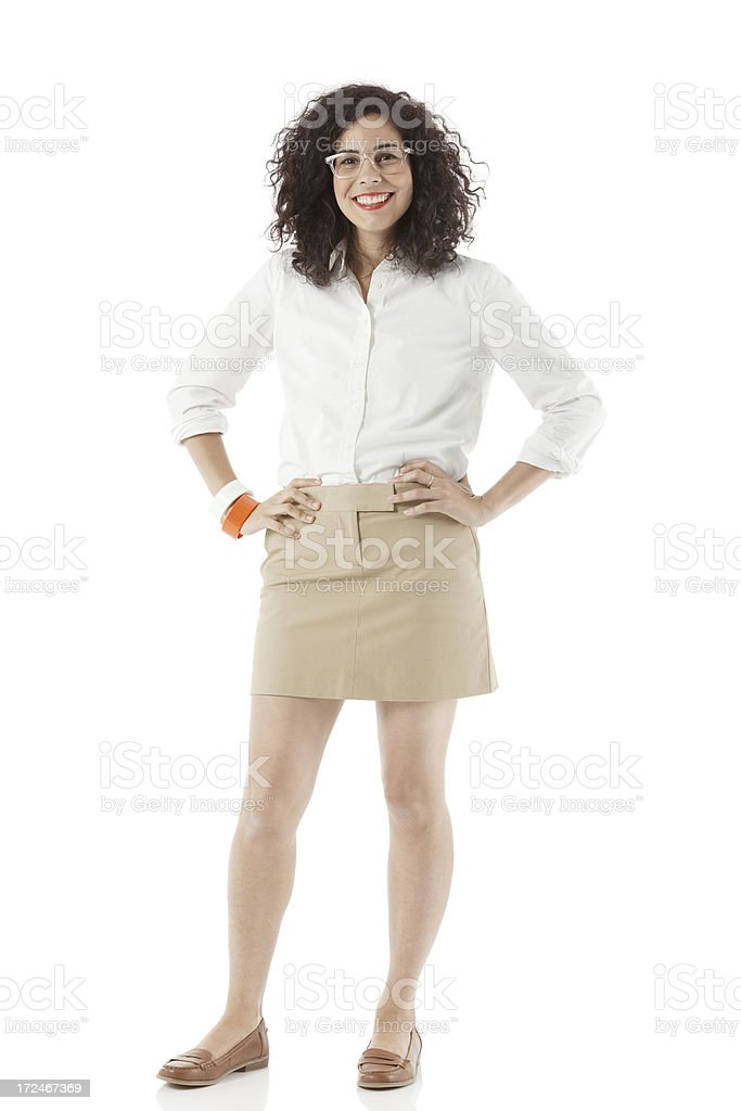 Businesswoman standing with hands on hips royalty-free stock photo