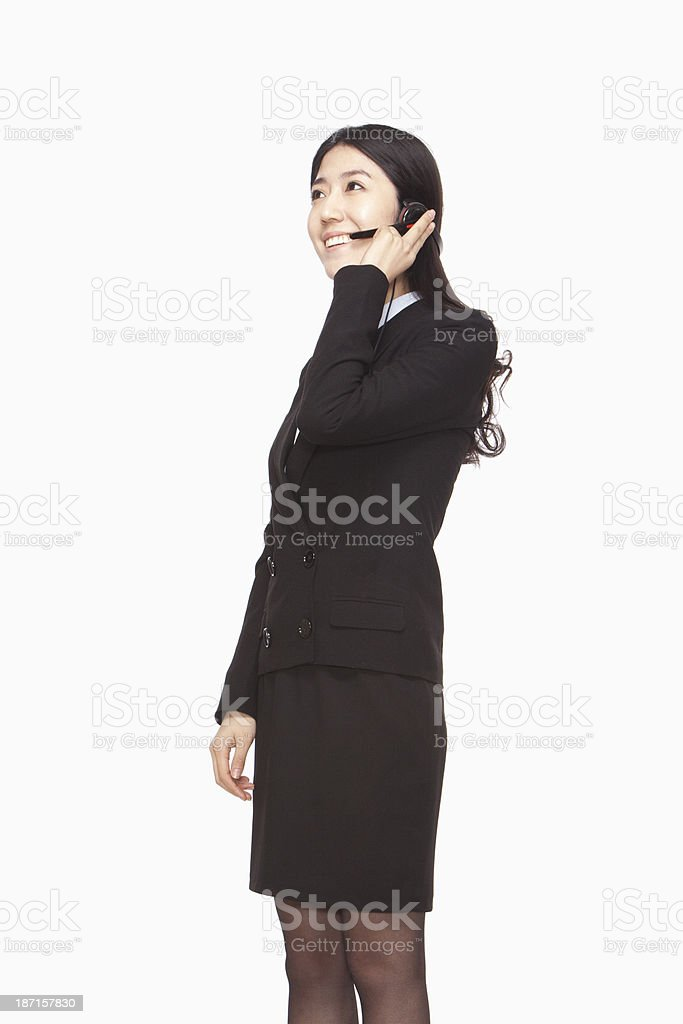 Businesswoman standing with headset royalty-free stock photo