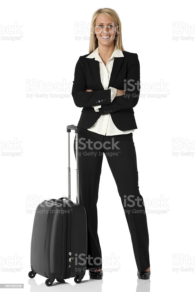 Businesswoman standing with luggage royalty-free stock photo