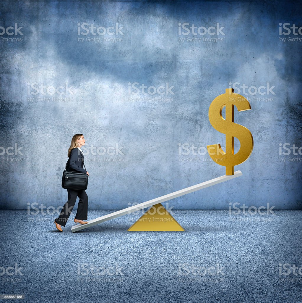 Businesswoman Stepping On To A Fulcrum Using Financial Leverage stock photo