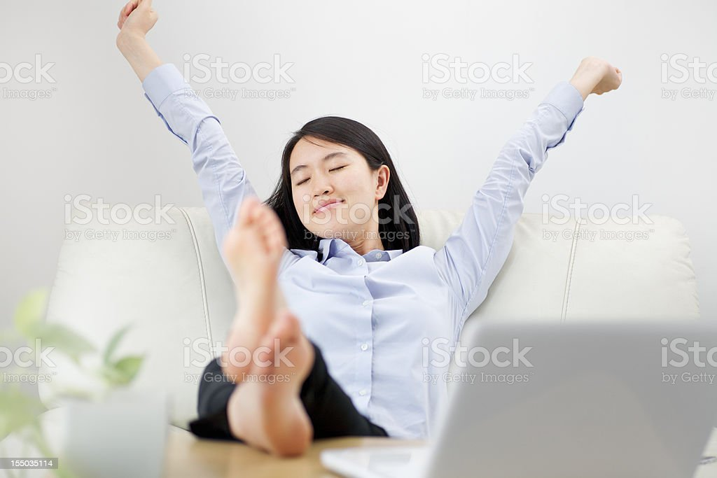 businesswoman stretches royalty-free stock photo