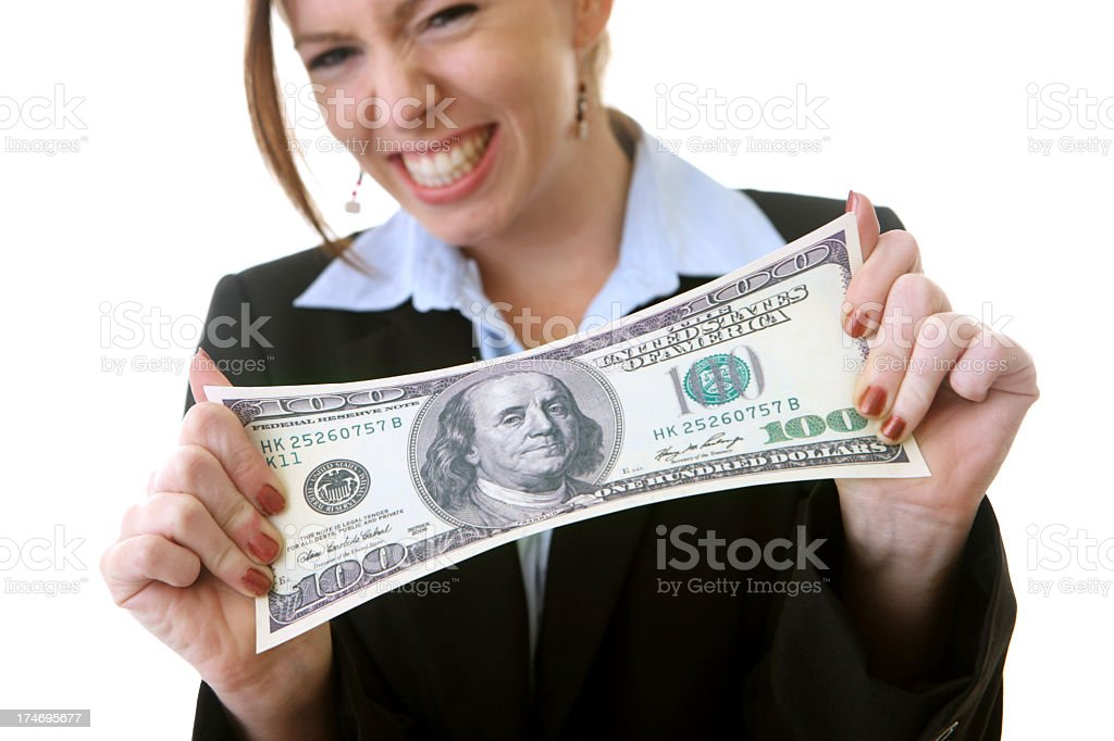 Businesswoman stretching her budget royalty-free stock photo