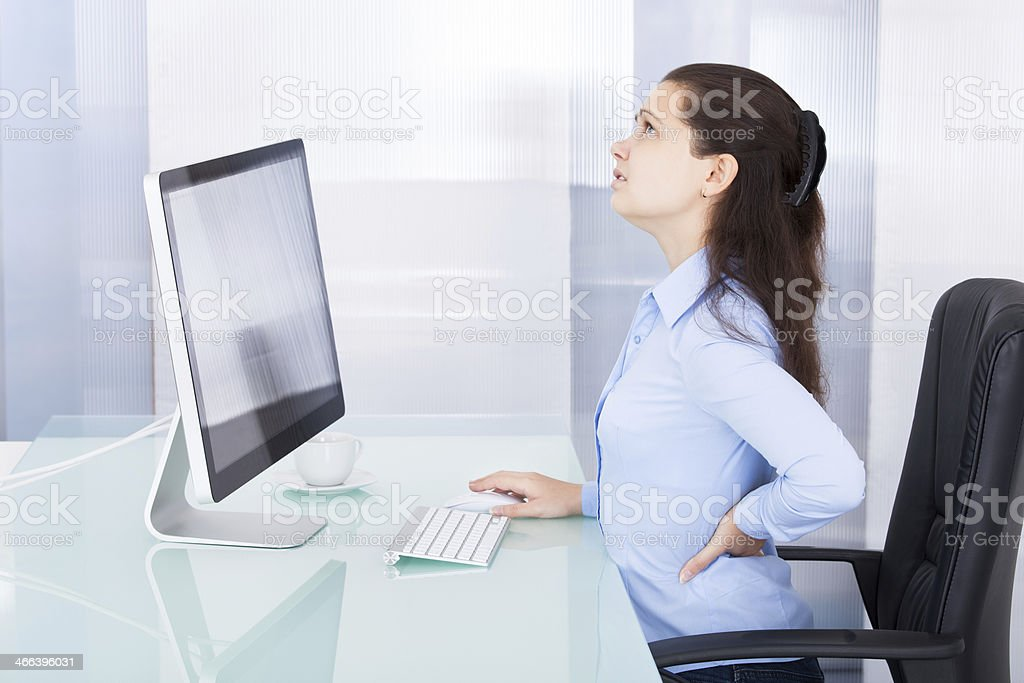 Businesswoman Suffering From Back Pain stock photo