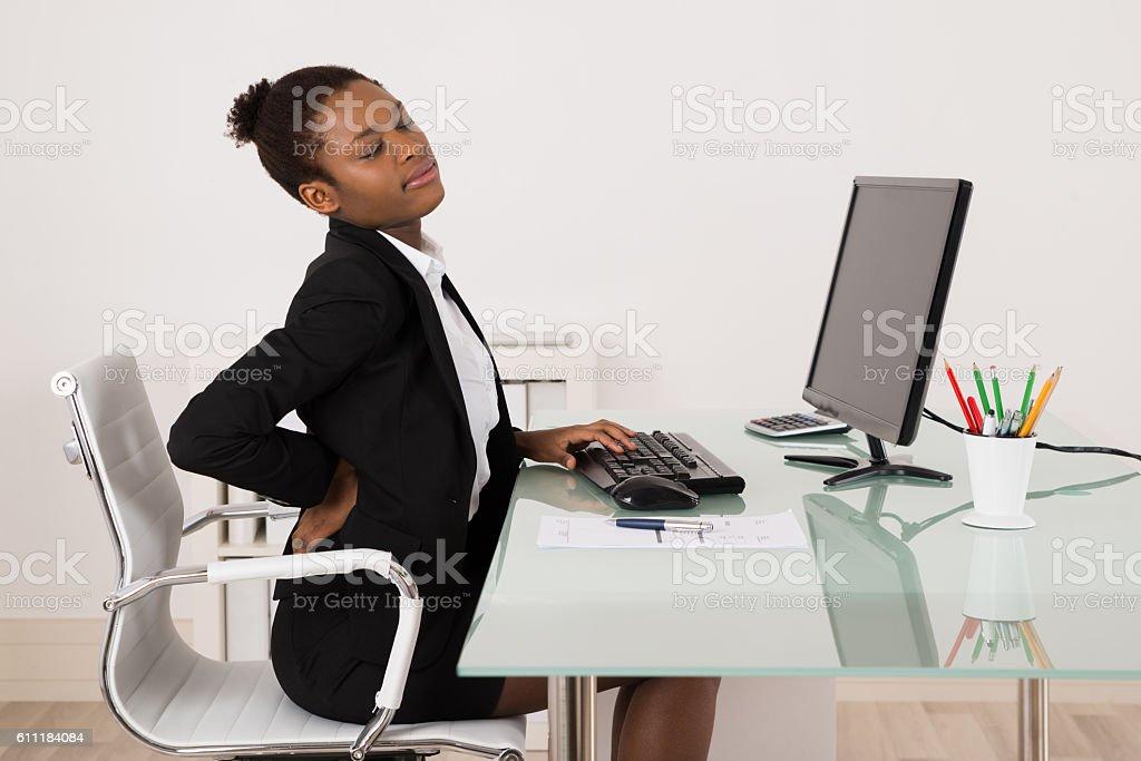 Businesswoman Suffering From Backache In Office stock photo