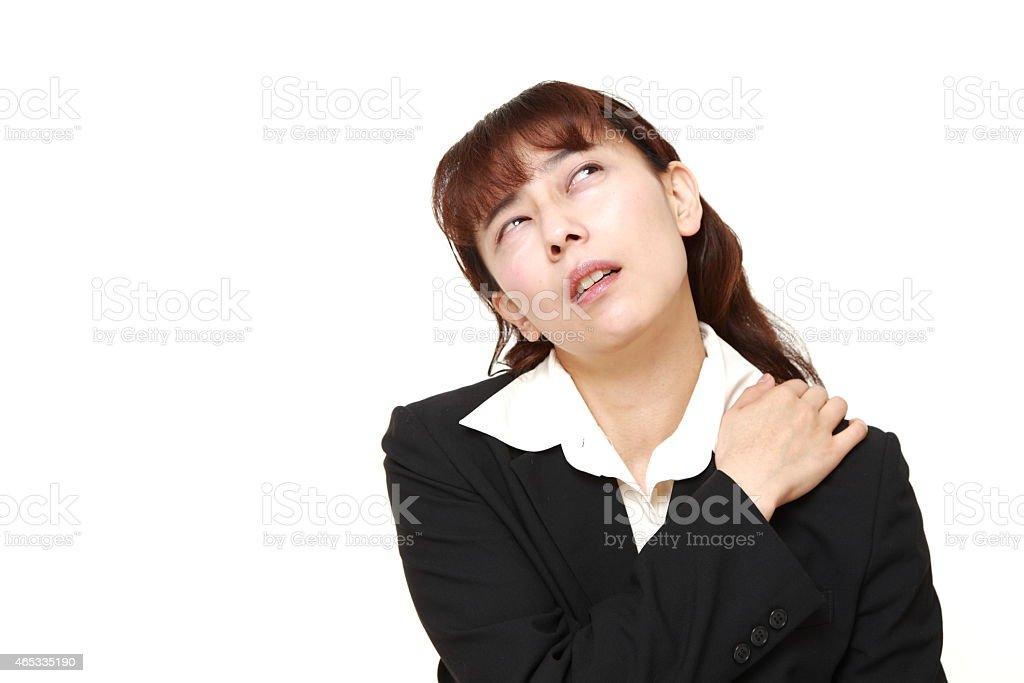 businesswoman suffers from neck ache stock photo