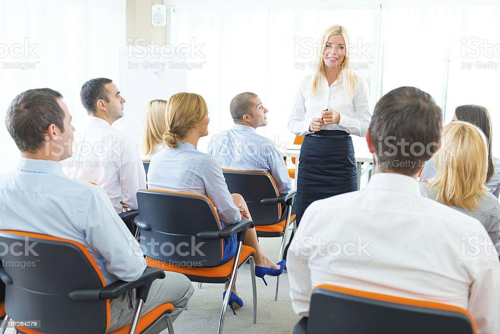 Businesswoman talking at business seminar. royalty-free stock photo