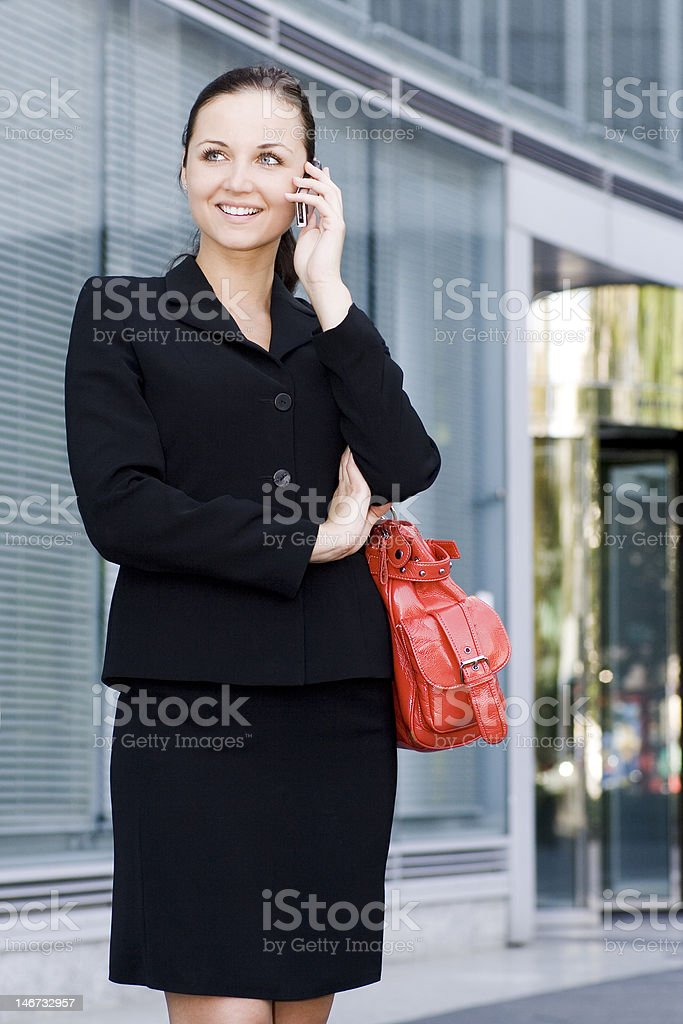 Businesswoman talking on a mobile phone royalty-free stock photo