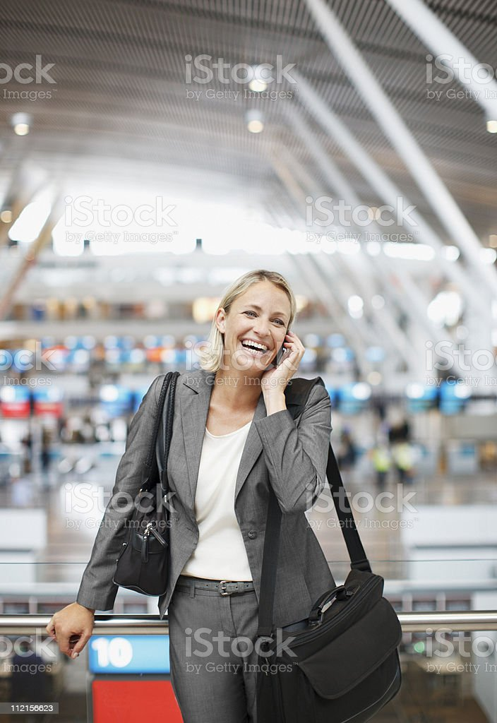 Businesswoman talking on cell phone in office royalty-free stock photo