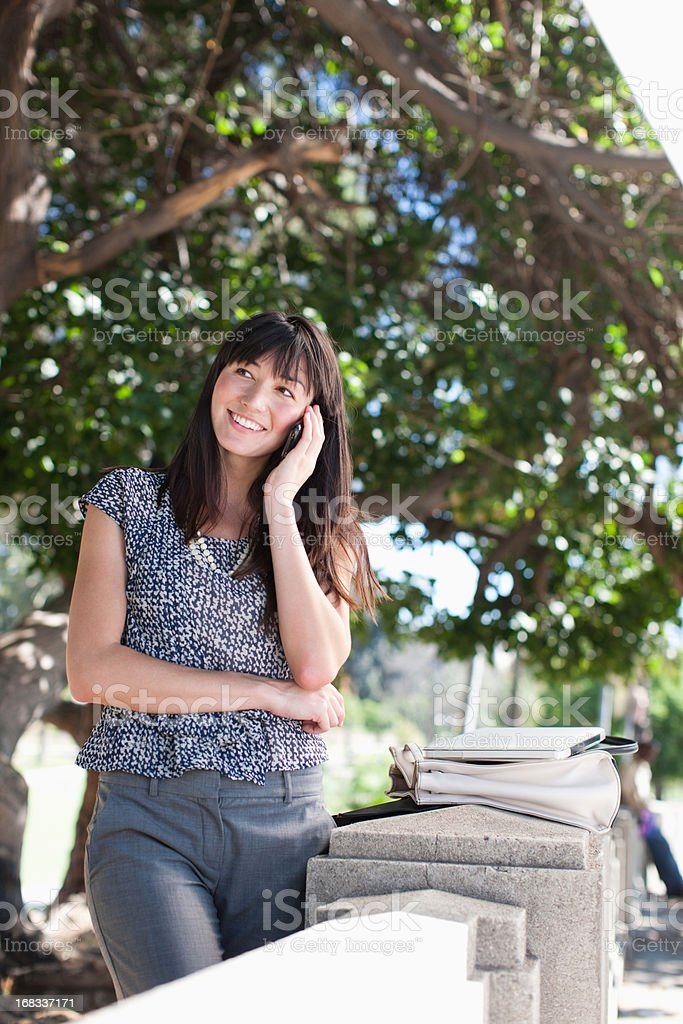 Businesswoman talking on cell phone outdoors royalty-free stock photo