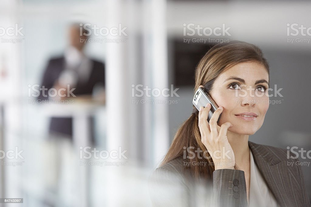 Businesswoman talking on cell phone royalty-free stock photo