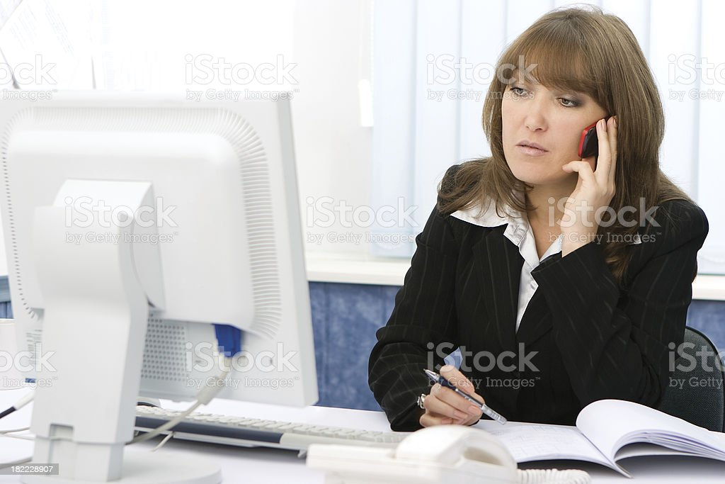 Businesswoman talking on cellphone royalty-free stock photo