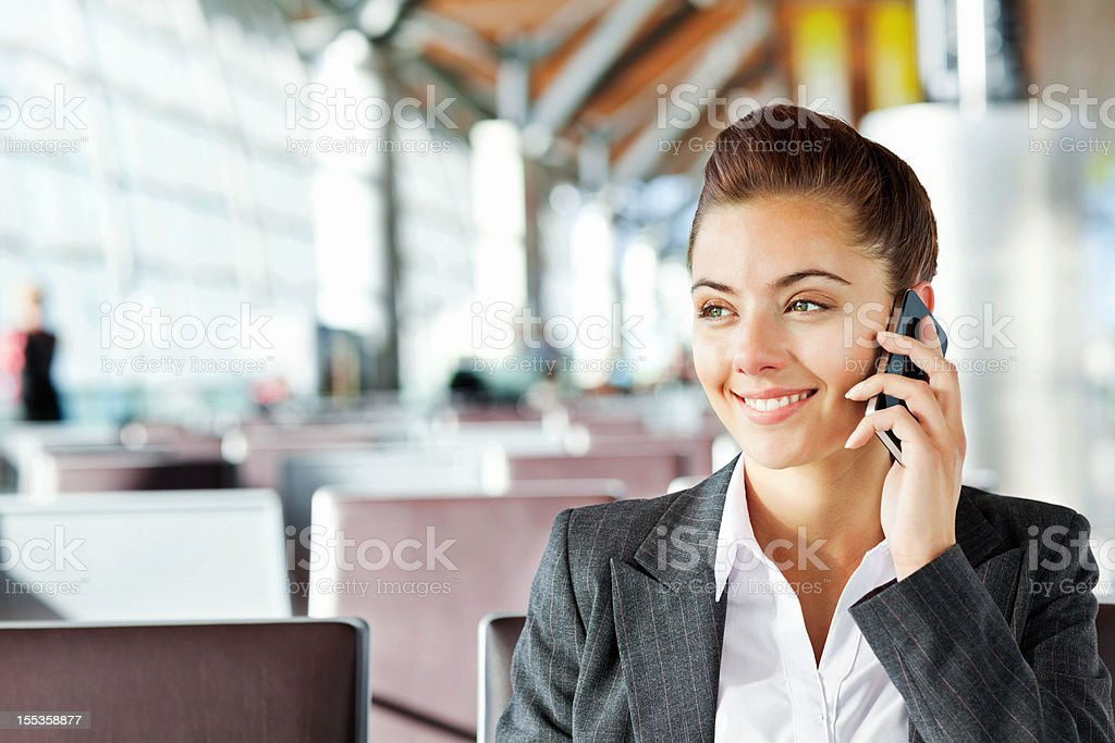 Businesswoman Talking On Mobile Phone at Airport royalty-free stock photo