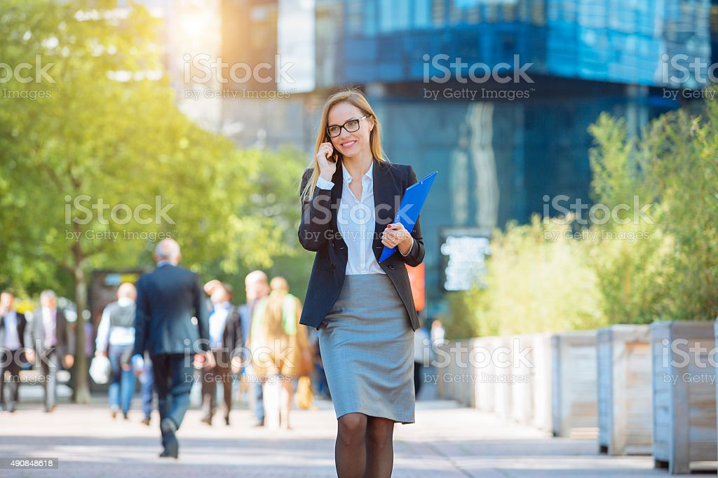 Businesswoman talking on mobile phone stock photo