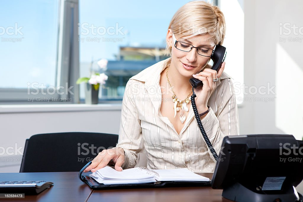 Businesswoman talking on phone royalty-free stock photo