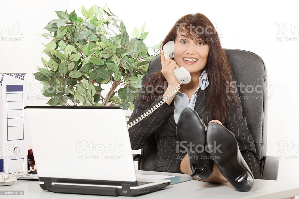 Businesswoman talking on telephone royalty-free stock photo