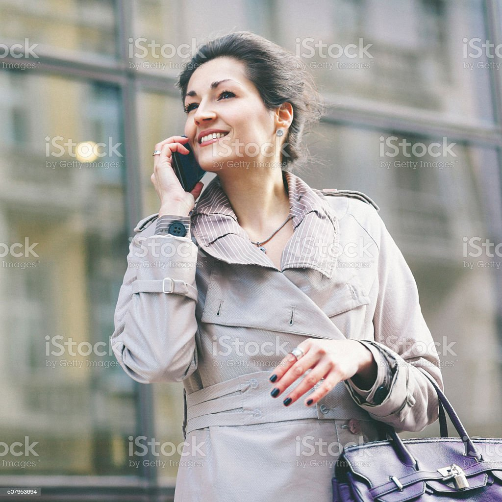 Businesswoman talking on the cell phone and smiling stock photo