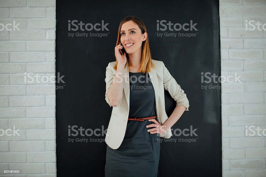 Businesswoman Talking On The Phone In Her Office. stock photo