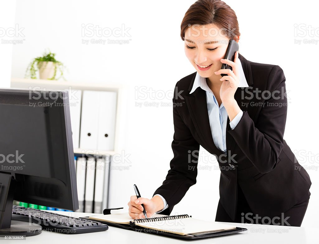 businesswoman talking on the phone in office stock photo