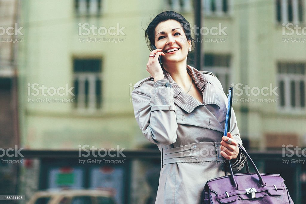 Businesswoman talking on the smart phone stock photo