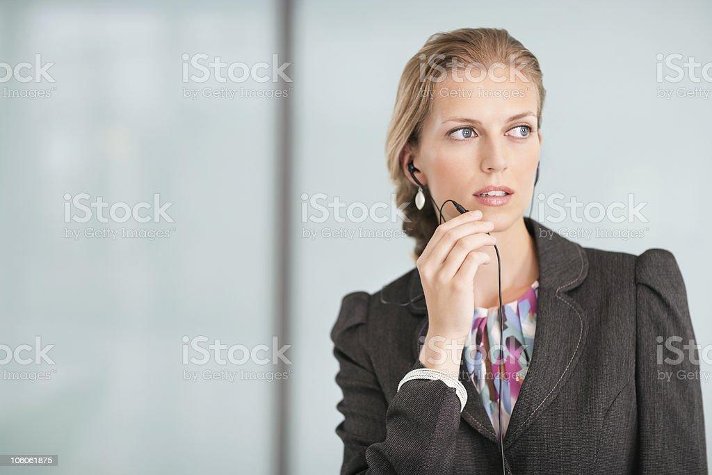 Businesswoman talking through headphones royalty-free stock photo