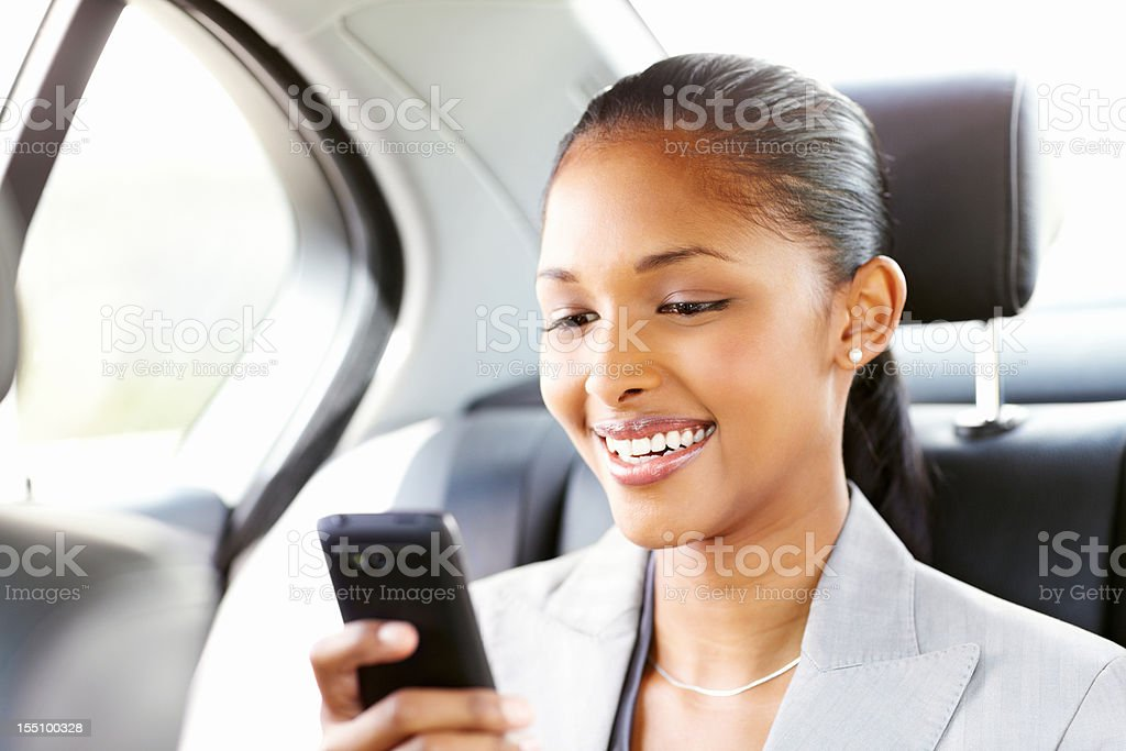 Businesswoman Texting in a Car stock photo